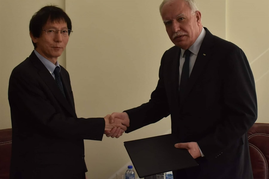 Minister Malki receives a copy of the nomination papers of the Japanese Representative...